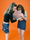 Women sharing a laptop 2 Royalty Free Stock Images