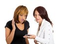Women shocked at what they see on the cellphone Stock Photos