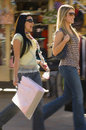 Women with shopping bags walking on street stylish young Royalty Free Stock Photo