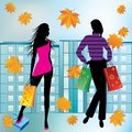 Women on shopping silhouettes of engaged in the background of autumn city Stock Photo