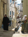 Women shopping at the souk bizerte tunisia carrying their in Royalty Free Stock Image