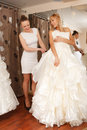Women shopping for wedding dress a bride to be a in a bridal boutique Royalty Free Stock Images