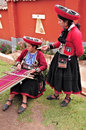 Women show process of production of the clothes from alpaca and llama wool on may in chinchero peru chinchero settlement locates Royalty Free Stock Image