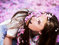 Women showered with pink petals beautiful young woman cherry blossoms in the air in spring day Royalty Free Stock Photo