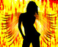 Women silhouette with fire Stock Photography