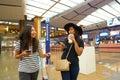 Women at Singapore Changi Airport Terminal 2 departure hall Royalty Free Stock Photo
