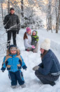 Women sisters with children and grandfather walking in winter forest Stock Image