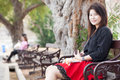 Women sitting on a bench asian woman black shirt in the park Royalty Free Stock Photos