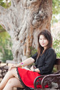 Women sitting on a bench asian woman black shirt in the park Stock Images