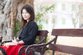 Women sitting on a bench asian woman black shirt in the park Royalty Free Stock Image