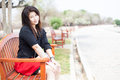 Women sitting on a bench asian woman black shirt in the park Stock Photos