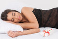 Women sleeping on the sofa beautiful young woman near gift box Stock Photo