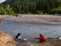 Women soaking at a remote river backpackers feet Royalty Free Stock Photography