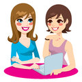 Women social networking two friends browsing on the internet and doing using a laptop Royalty Free Stock Photo