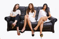 Women on sofa Royalty Free Stock Image
