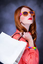 Women with sopping bags redhead woman studio shot Royalty Free Stock Photos