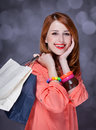 Women with sopping bags redhead woman studio shot Stock Photography