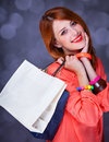 Women with sopping bags redhead woman studio shot Royalty Free Stock Photo