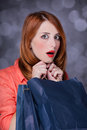 Women with sopping bags redhead woman studio shot Stock Images