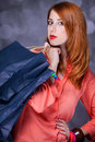 Women with sopping bags redhead woman studio shot Royalty Free Stock Photography