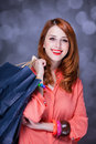 Women with sopping bags redhead woman studio shot Royalty Free Stock Images