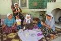 Women spin wool for carpet production in Karacahisar, Turkey.