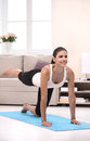 Women stretching cheerful young women exercising at home woman while standing on the exercise mat Stock Image