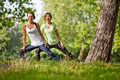 Women stretching outdoors Stock Images