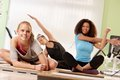 Women stretching after workout attractive doing exercises at the gym Stock Images
