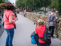 Women taking photographs of tourists viewing love one woman kneels to shoot photo with a dslr while another has her smart phone Royalty Free Stock Photo