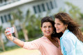 Women taking a picture with the phone of themselves mobile Stock Photography