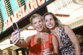 Women Taking Self Portrait In Front Of Casino Stock Photography