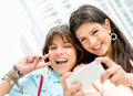 Women taking a self portrait happy with mobile phone Royalty Free Stock Photo