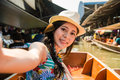 Women taking selfie on floating market holiday Royalty Free Stock Photo