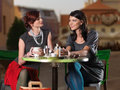 Women talking over coffee in the town square Stock Image
