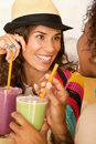 Women Talking Over Smoothies Stock Photography