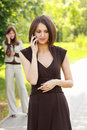 Women talks on phone Stock Image