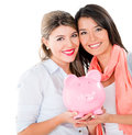 Women with their savings in a piggybank isolated over white Royalty Free Stock Photo