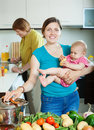 Women of three generations in domestic kitchen happy Stock Images