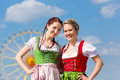 Women in traditional bavarian clothes or dirndl on festival young tracht a oktoberfest Royalty Free Stock Photos