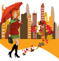 Women with umbrella in the city Stock Image