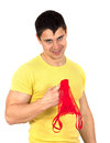Women underwear young athletic muscular man holding red woman and looking sexy isolated on white background Royalty Free Stock Image