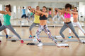 Women use resistant rubber for exercises young in gym Royalty Free Stock Photography