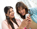 Women using app on a cell phone happy Royalty Free Stock Photos