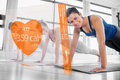 Women using interface at the gym modern orange Royalty Free Stock Images