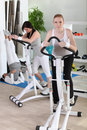 Women using stepper machine in gym Royalty Free Stock Photography