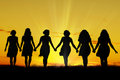 Women walking hand in hand Royalty Free Stock Photo