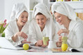 Women wearing a white bathrobes with laptop Royalty Free Stock Photo