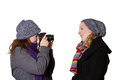 Women winter clothes camera shooting Royalty Free Stock Photo