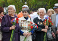 Women world war ii veterans sochi russia may with flowers in their hands celebrate victory day on may in sochi russia Royalty Free Stock Photography